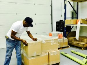 RICHARD, PRODUCTION MANAGER, OVERSEES PACKING OF LARGE ORDERS